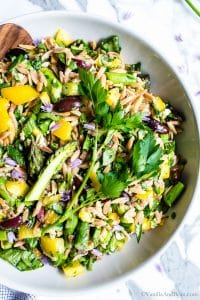 Closeup of Lemon Orzo Salad with Asparagus, Spinach and Feta in a large serving bowl ready to be shared