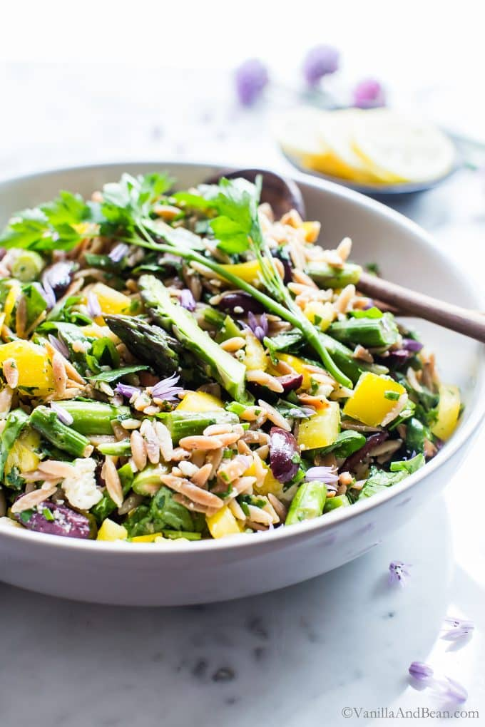Lemon Orzo Salad with Asparagus, Spinach and Feta in a large serving bowl.