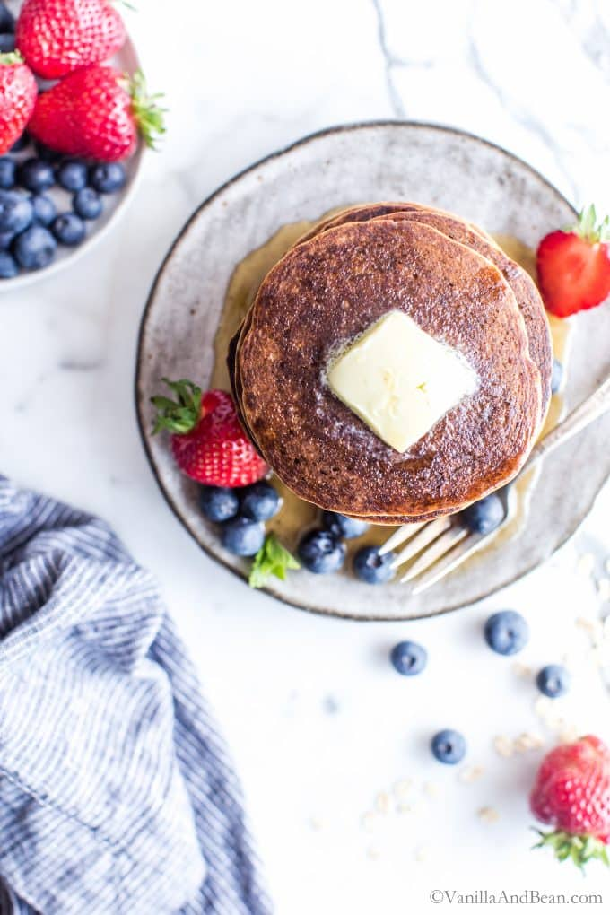 Gluten free oatmeal pancake recipe with butter on top.