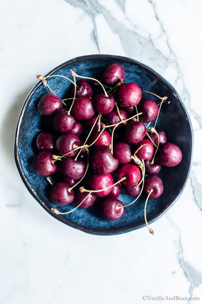 A bowl full of fresh Bing Cherries