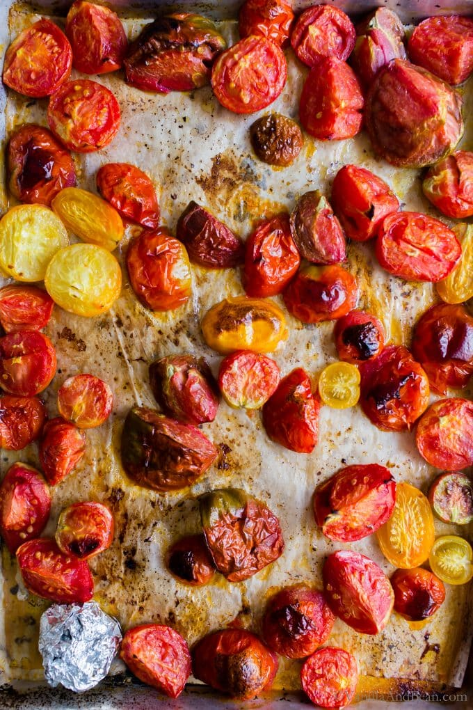 Roasted tomatoes on a sheet pan.