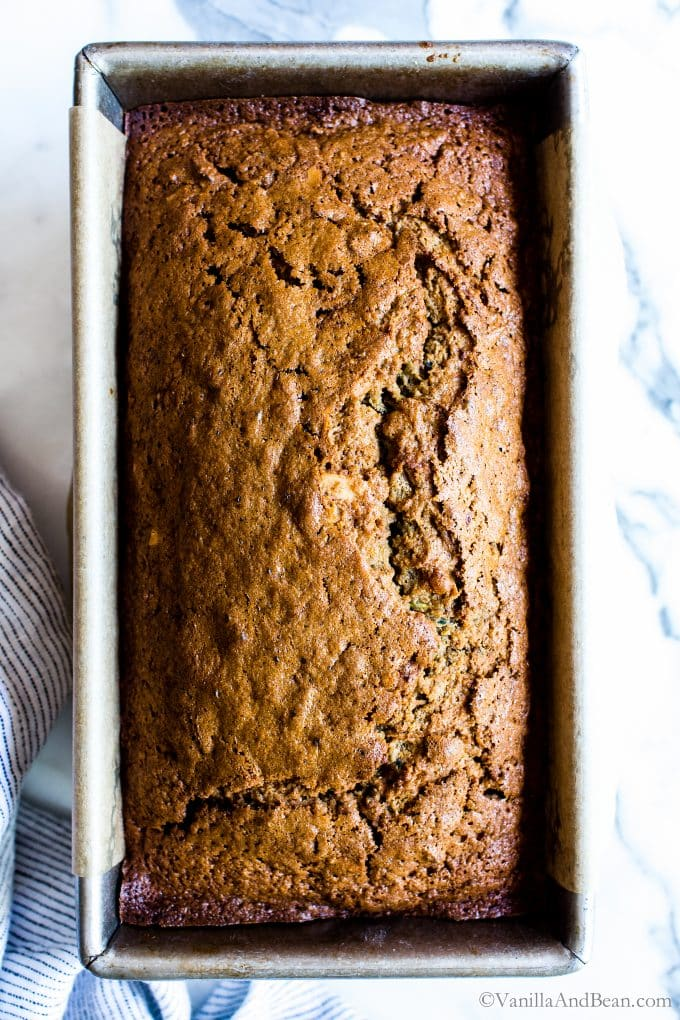 Brown sugar sweetened zucchini bread in a loaf pan.