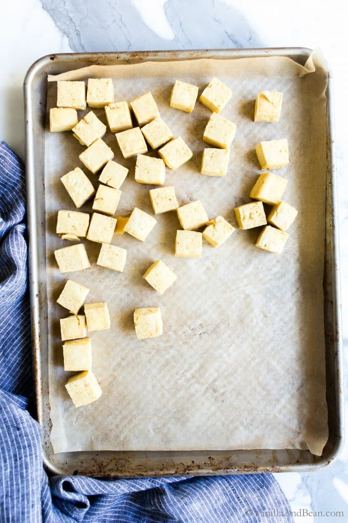 Baked Tofu Squares on a sheet pan.