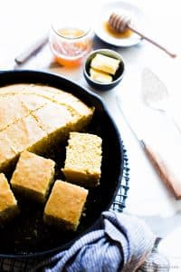 Gluten free cornbread cut in a skillet.
