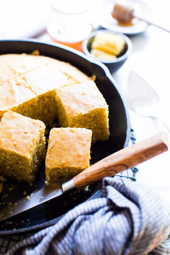 Gluten Free Cornbread in a skillet with a knife.