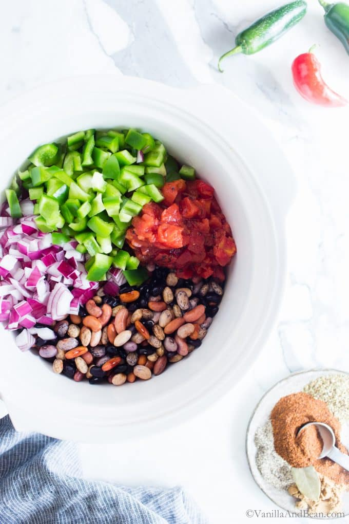 Vegan chili ingredients in a crock pot ready to cook.