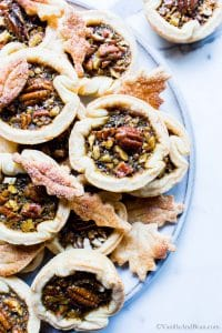 Mini Pecan Pies with No Corn Syrup shared on a serving plate.