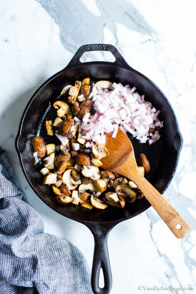 Sautéed Mushrooms and Shallots in a skillet.