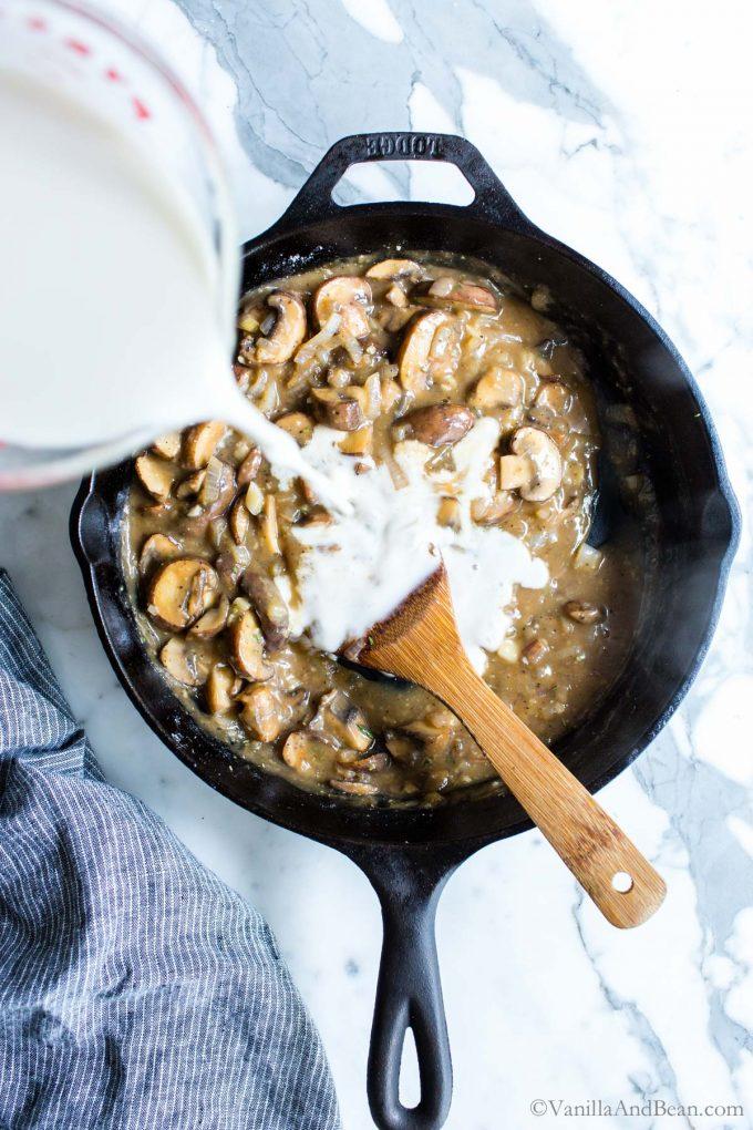 Milk pour into homemade cream of mushroom soup