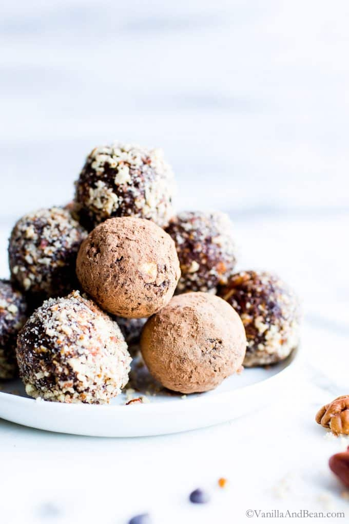 Bliss Balls stacked up on a plate.