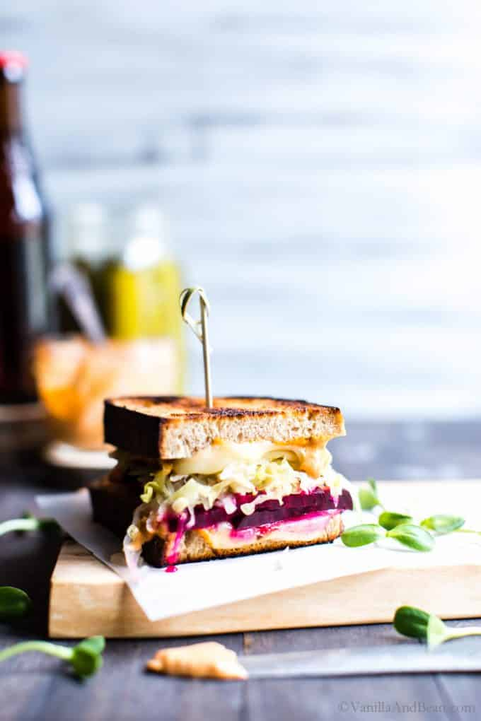 Ready to eat Vegetarian Reuben Sandwich setting on a board.