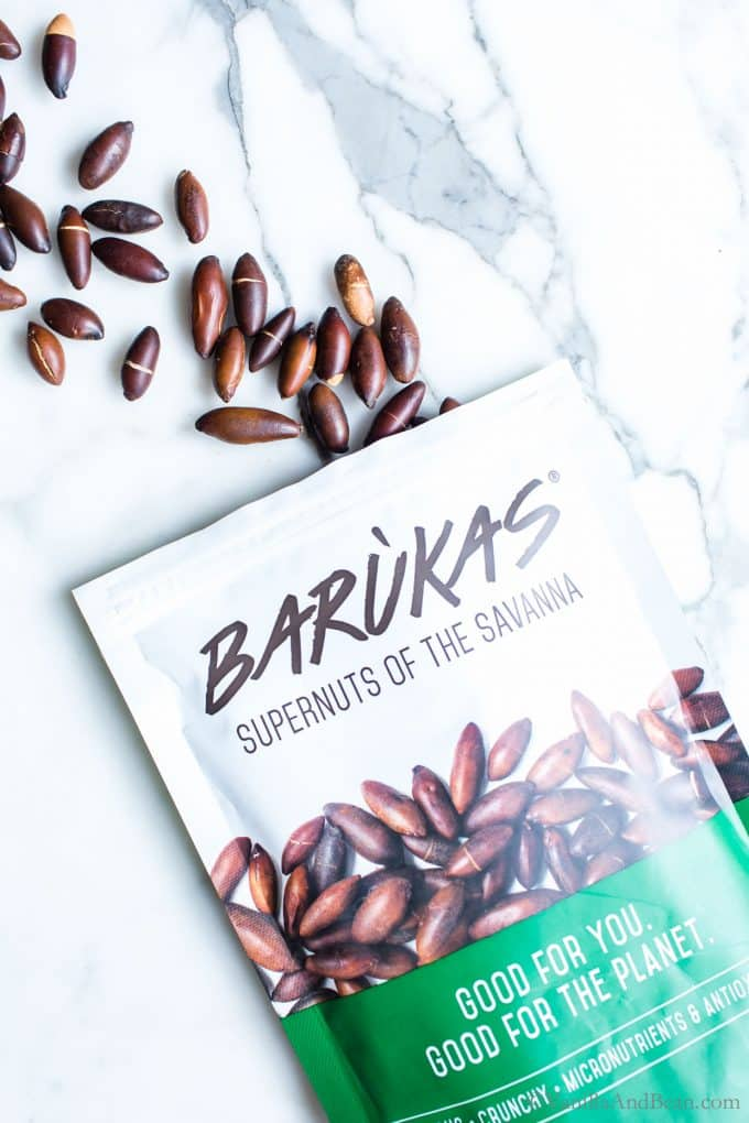 Baruka nuts falling out of an open bag.
