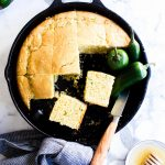 Sliced Jalapeño Cheddar Cornbread in a skillet ready for sharing.