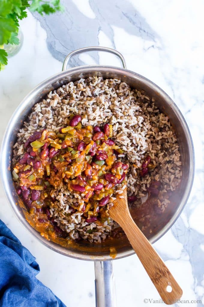 Vegetarian Dirty Rice in a skillet just incorporating the lentils and rice with the bean mixture.