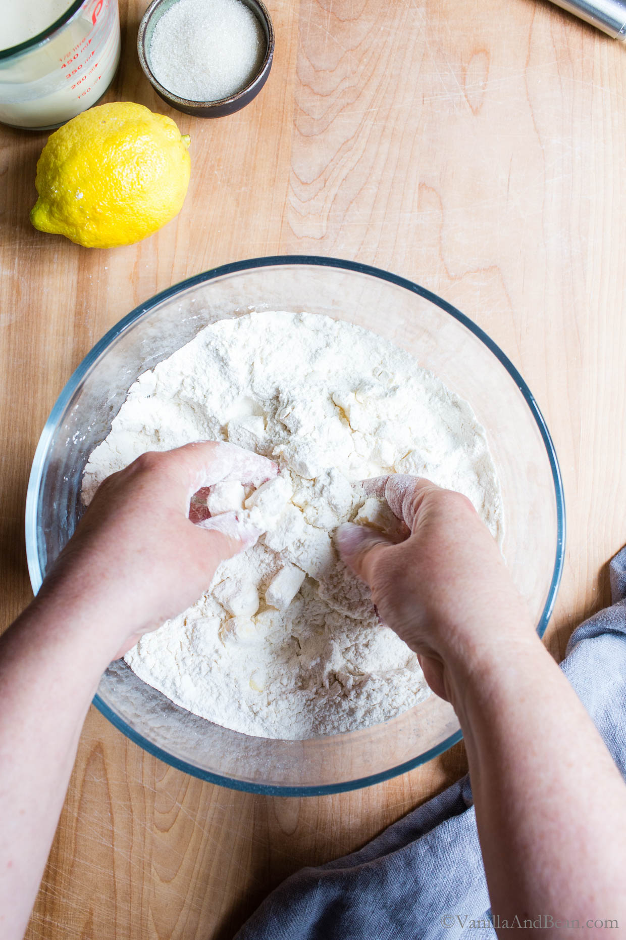 Cutting the butter into the flour using hands.