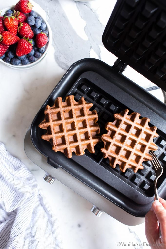 Sourdough waffles just baked in a waffle iron.