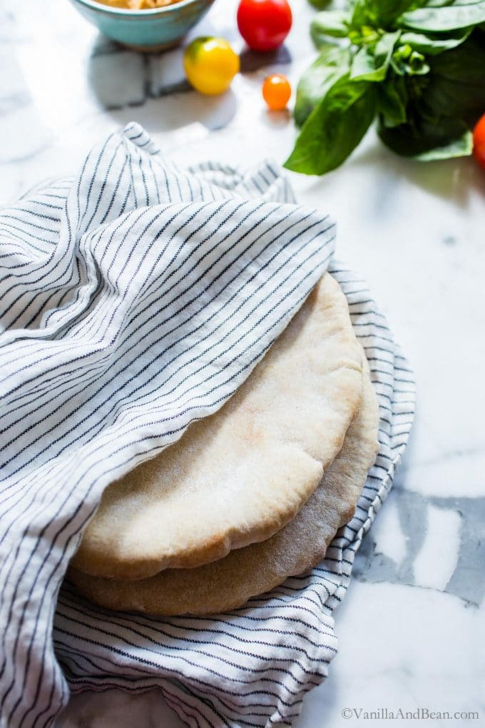 Pita bread covered in a tea towel.