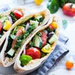 Greek Pita Sandwiches on a serving plate.