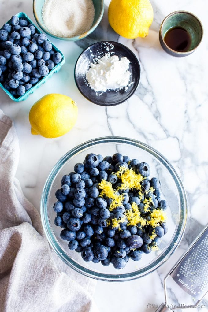 Blueberries with lemon zest in a bowl.