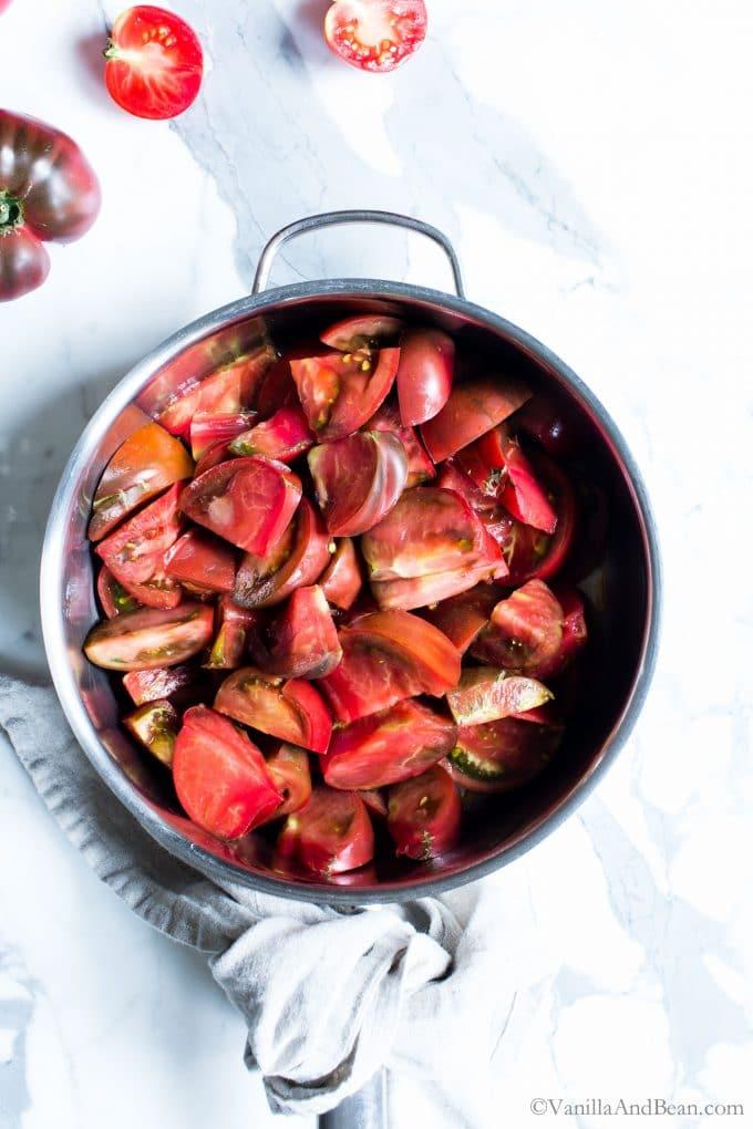 Fresh juicy tomatoes in a pan.