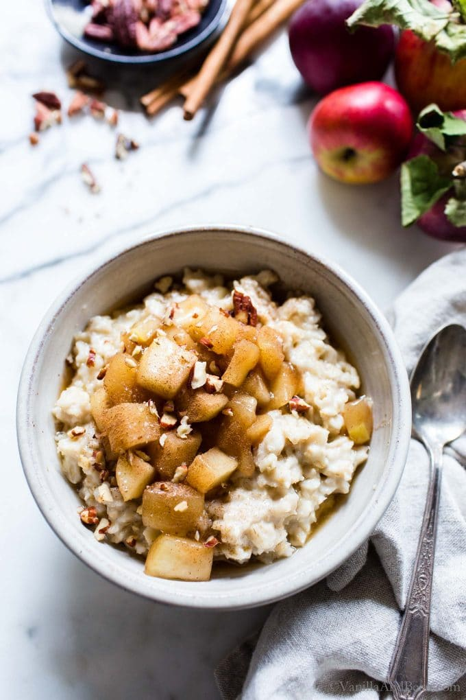 Stewed apples with cinnamon in a bowl with oatmeal.