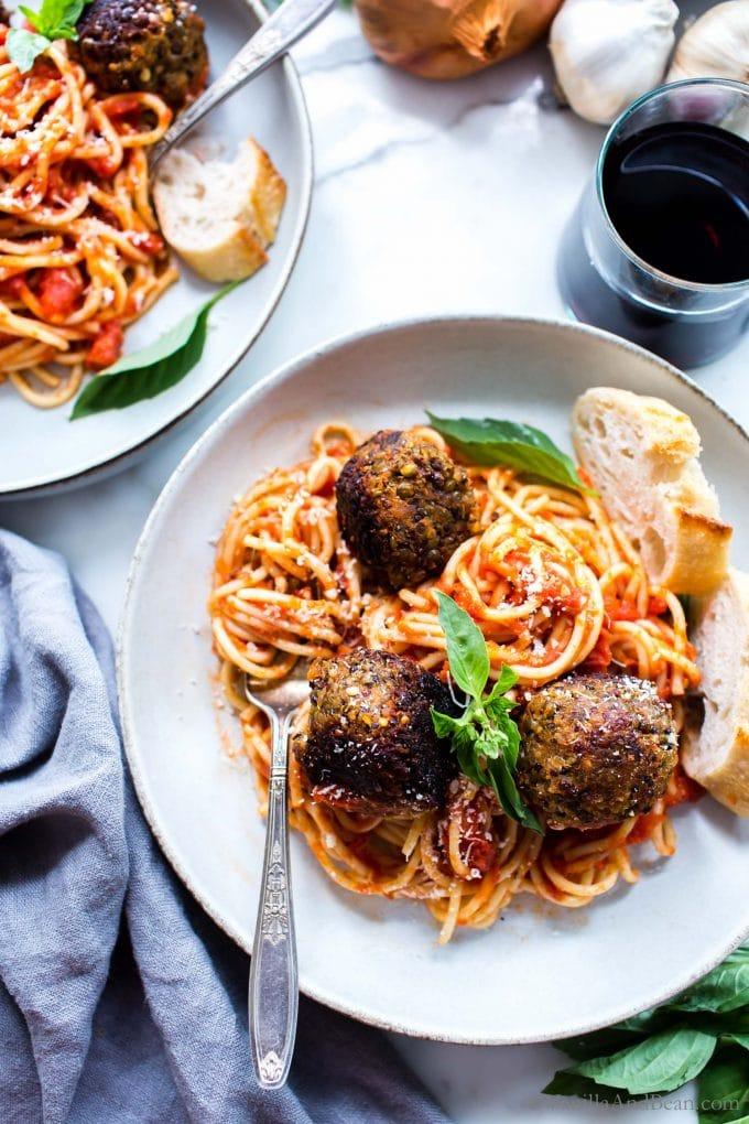 Overhead shot of Eggplant Meatless Balls on spaghetti with basil.