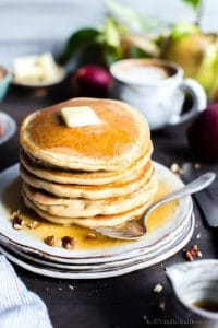 A stack of oatmeal pancakes on a plate.