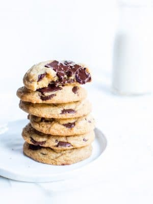 Sourdough Chocolate Chip Cookies stacked on a plate.