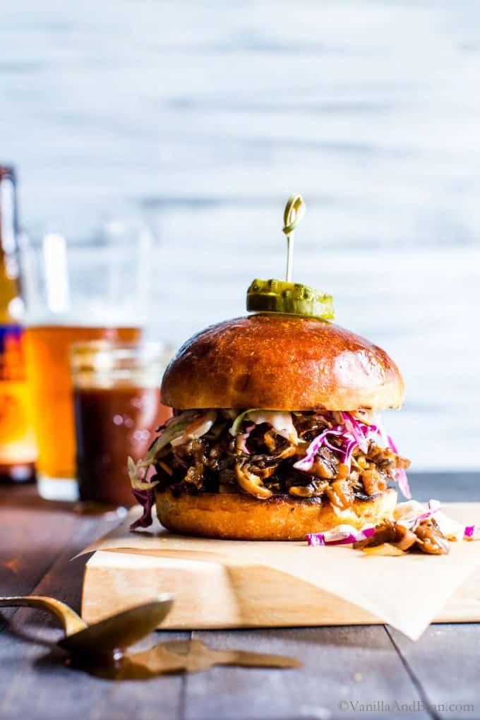 Pulled Portobello Vegan BBQ Sandwich with slaw on a cutting board.