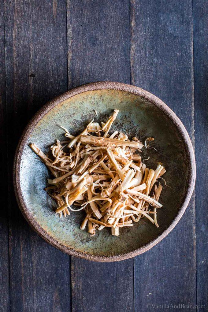Pulled Portobello Mushrooms stems in a bowl.
