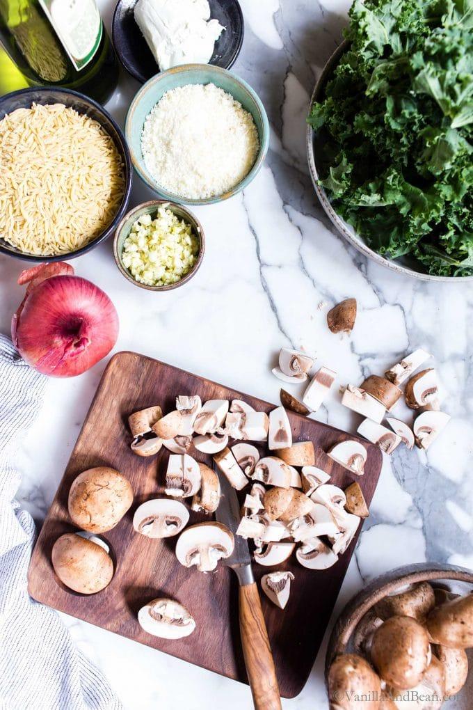 Chopping Mushrooms on a cutting board.
