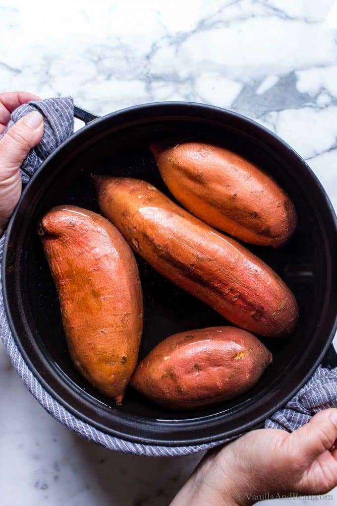 Sweet potatoes in a large pot of water.