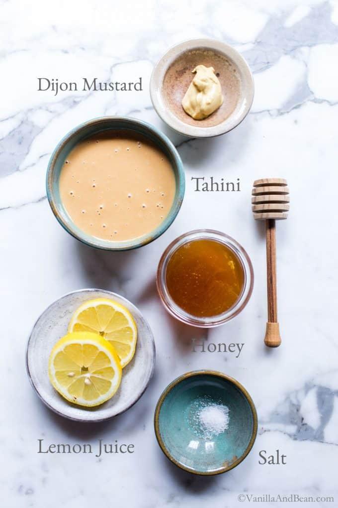 Honey tahini dip ingredients on a marble table.