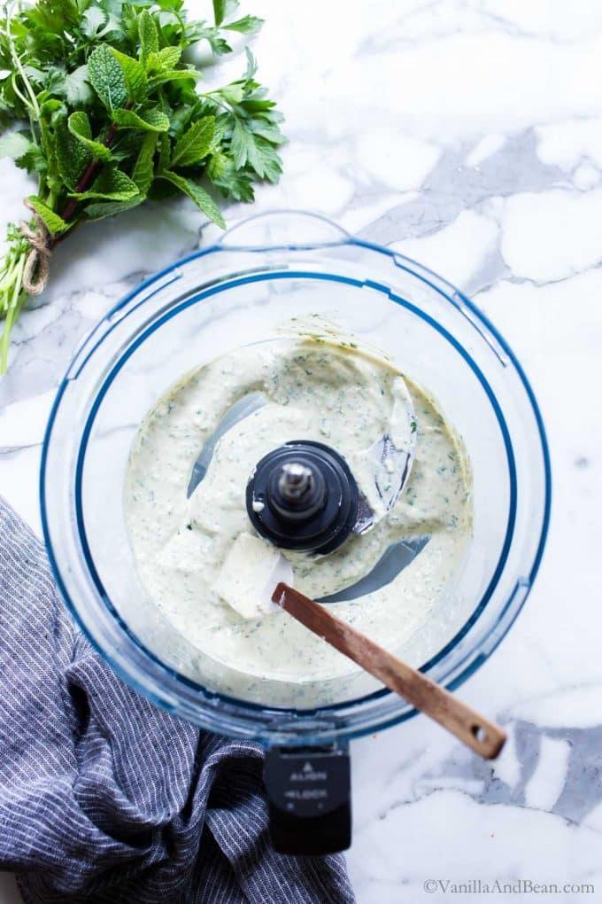 Yougert tahini dip in the bowl of a food processor.