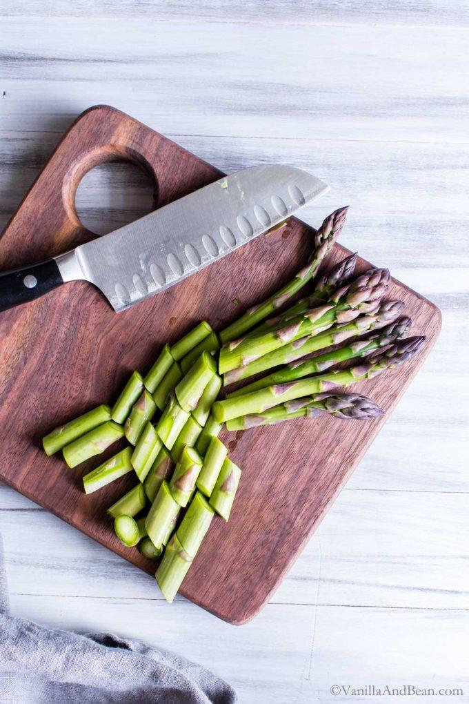 Sliced asparagus on a cutting board.