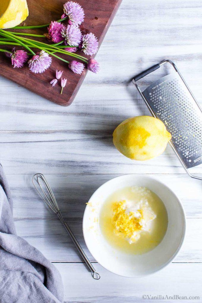 Making lemon dijon dressing for the Spring pasta salad.