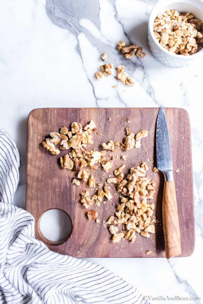 Chopped Walnuts on a Cutting Board.
