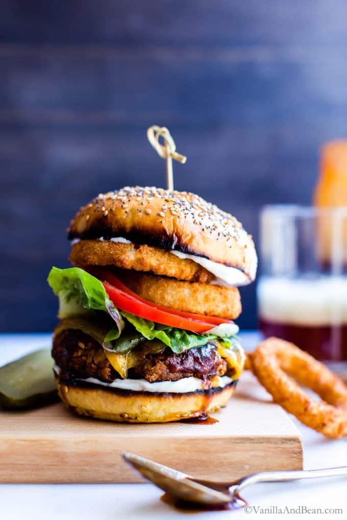 Chickpea Burger with lettuce, tomato and onion rings between two buns.